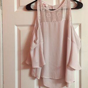 A cute light pink shirt.
